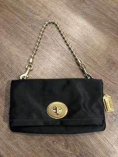 Coach black silk & brass clutch