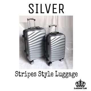 Silver Medium size luggage