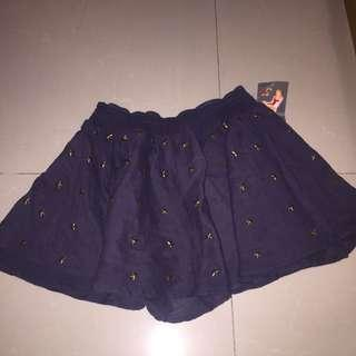 Skirt from U.K.  ( with metal stars )