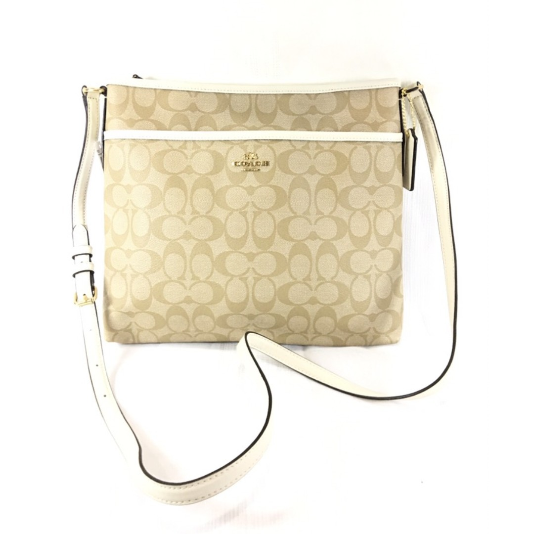 1b7baab834 Coach Light Khaki Coated Canvas and Chalk Leather Signature File Bag ...