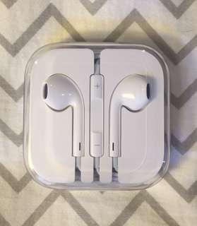 Apple EarPods still in case