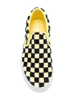 Furry checkerboard slip on vans in yellow and black