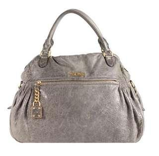 Authentic Miu Miu charm satchel