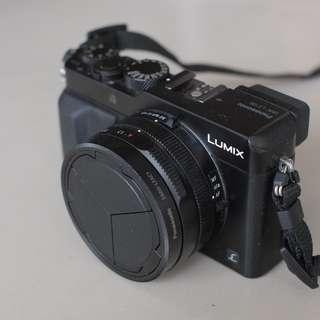 Panasonic LX100 with self-closing hood