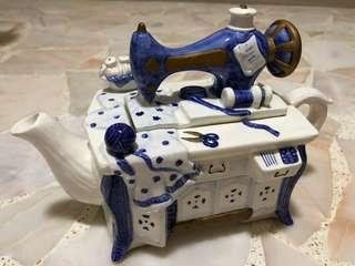 Porcelain teapot with sewing machine design