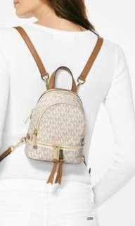 Looking for michael kors xs backpack vanilla logo