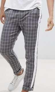 Brand new ASOS checkered pants with white side stripes