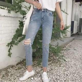 Women's high waist ripped jeans with raw hem