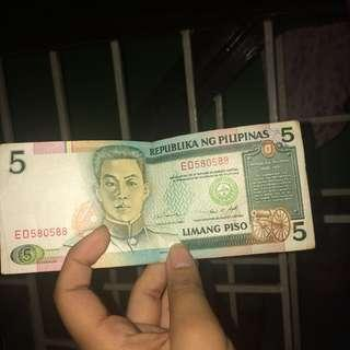 Limang pisong papel