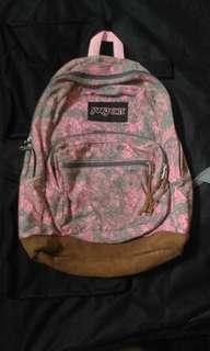 Jansport's backpack pink w/ floral design