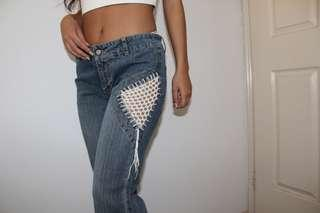 Flare jeans with knitted design