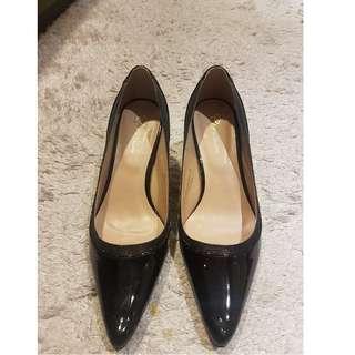 Calliope black patent heels