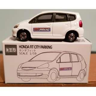 Tomica No. 100 First Generation Honda Fit City Parking 2002 from Tomica DX Odekake Rittai Map Play set