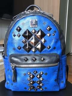 100% Authentic MCM Limited Edition Stark Brock BLUE Small Backpack with Silver & Black scattered pyramid stud embellishment