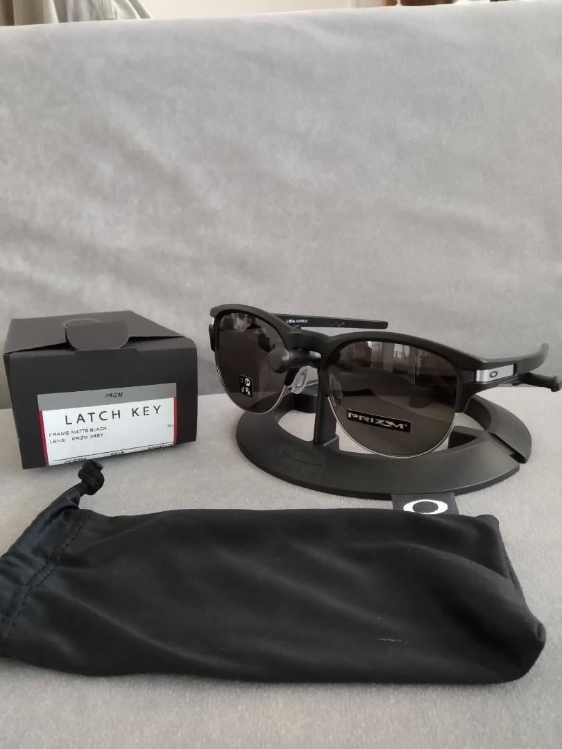 7828aa50377 Oakley latch key size large 55mm prizm grey lens