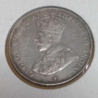 1920 Straits Settlements 50 cents coin.