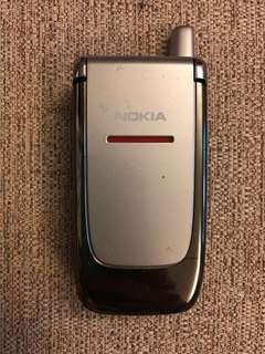 Nokia mobile phone (plus universal charger)