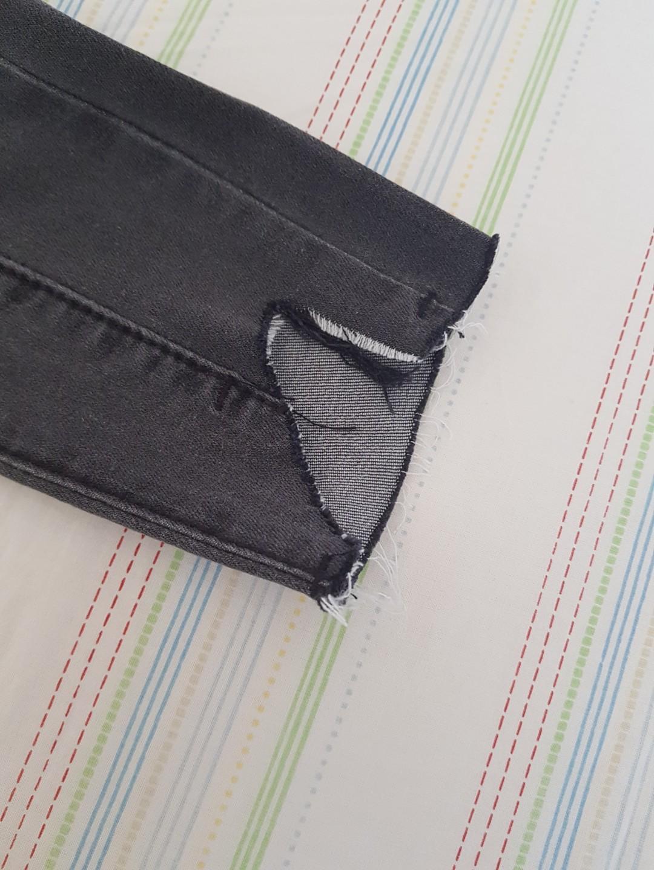 Dark grey denim jeans ripped ends