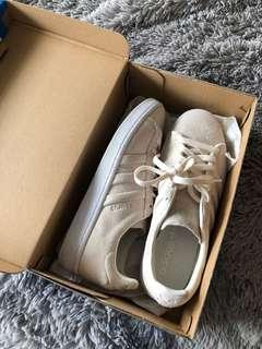 Adidas cream shoes