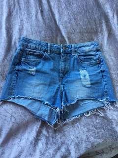 Light wash blue denim ripped shorts
