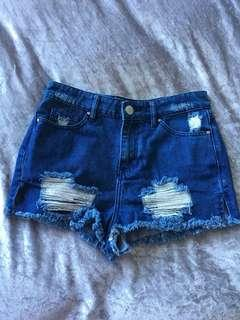 Dark blue denim shorts with rips
