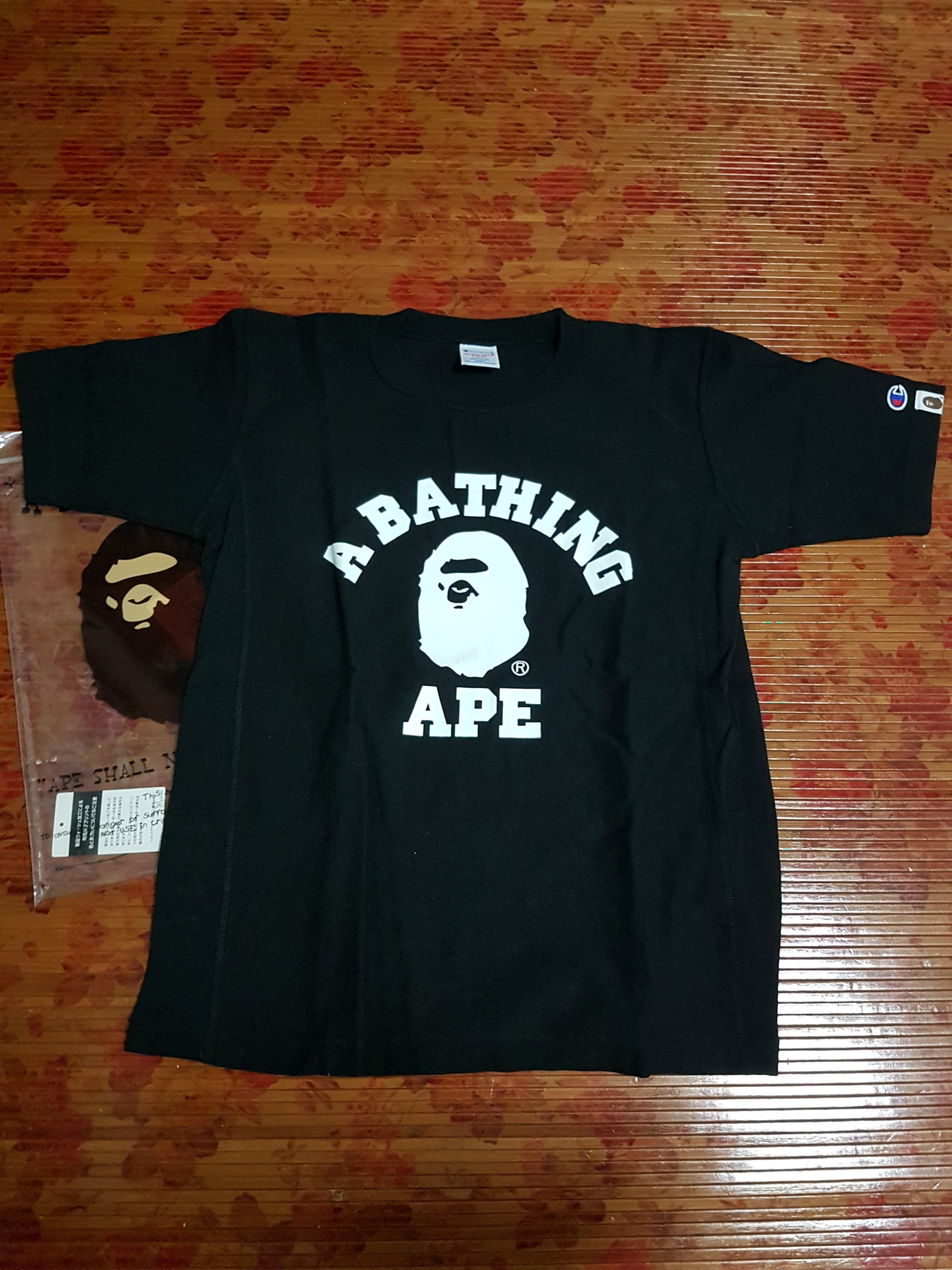 956780eca Bathing ape X Champion, Men's Fashion, Clothes, Tops on Carousell