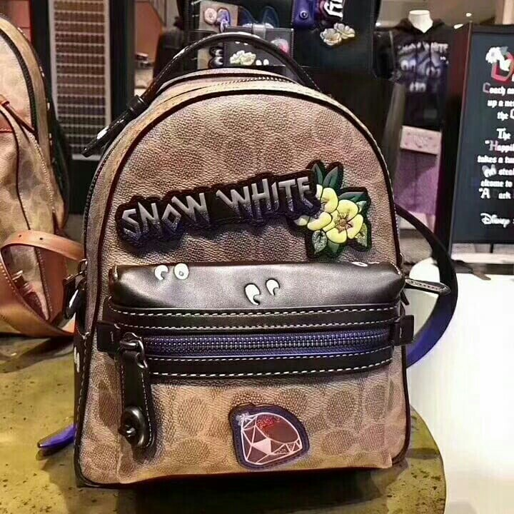 9c45d6b3d8f disney x coach campus backpack 23 in signature patchwork . Style no ...
