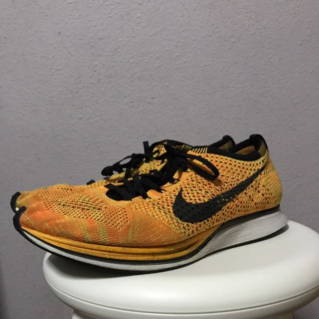 8d9b6d284967 Nike flyknits racers cheetos us 10.5