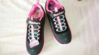 Kids Skechers running shoes