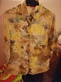 Ladies' Blouse with front buttons.