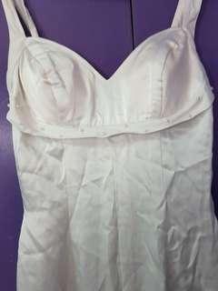 White sleeveless gown