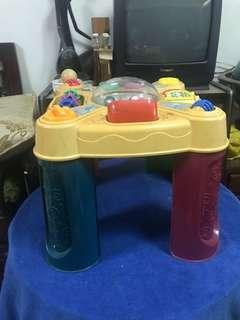 Fisher price table and many teaching gazettes