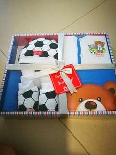 Pureen gift...baby vests, mittens, towel, bib, pants, booties and shirt