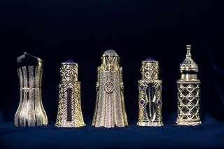 Bronze Bottles with Branded Oil Perfumes
