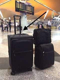 Tumi Black Nylon Roller Luggage (expandable four wheeled)