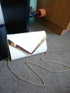 Colette White and gold clutch bag