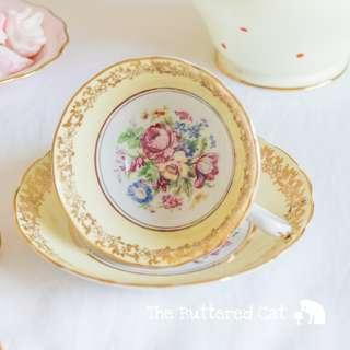 Pretty vintage English bone china cabinet cup and saucer, pale pastel yellow, floral spray