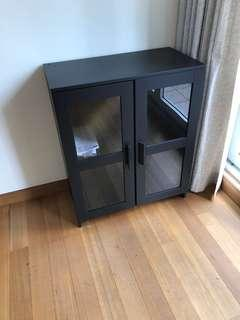 Low wooden cabinet with glasses interior