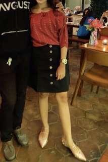 Black button skirts