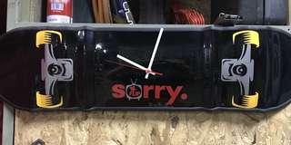 Metal skateboard wall clock