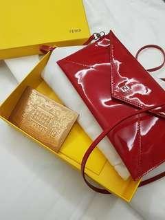 Fendi red patent sling