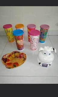 6 x brand new plastic cups with cover, 3 plastics love shape plates and 1 cow coin bank with free delivery