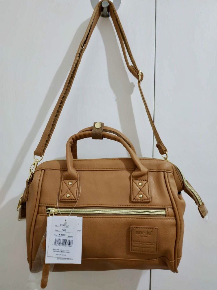 AUTHENTIC Anello Faux Leather Hinged Clasp Mini Shoulder Bag Tan, Women s  Fashion, Bags   Wallets on Carousell 777d0883f4