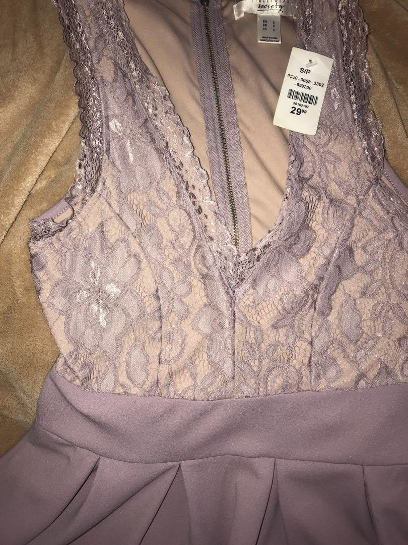 Beautiful violet dress size small with price tag on