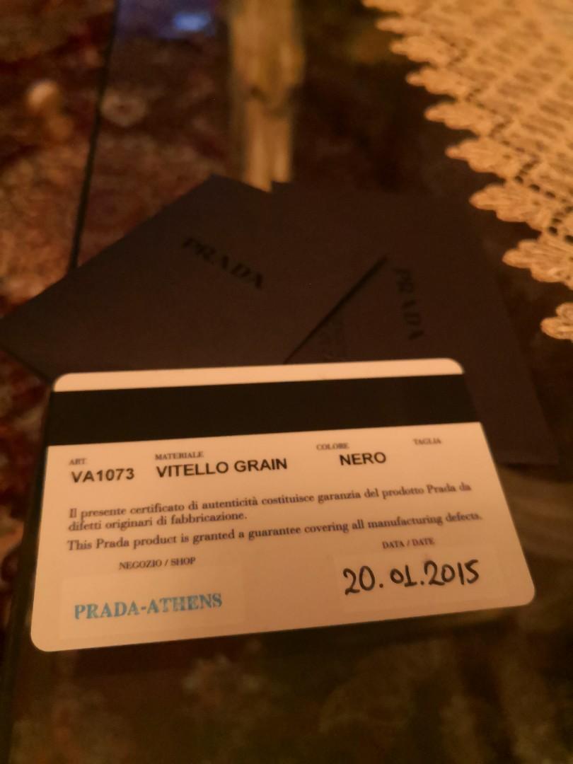 Pre loved authentic Nero Prada Virtelo Strain (VA1073) shoulder cross body messenger bag for sale.
