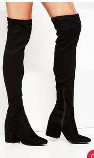 Thigh high black boots