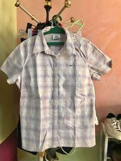Authentic Lacoste Polo in very good condition can fit small to medium frame
