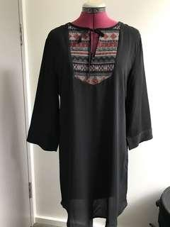 Size M free flowing dress black with tribal patterns