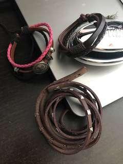 Three leather bracelets.