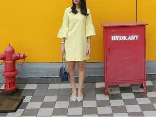 Yellow trumpet dress